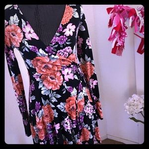 Long sleeve black and floral dress.